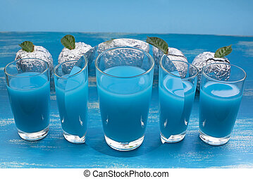 glass glasses with blue cocktail drink