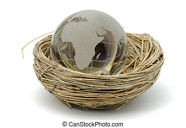 Glass Globe in a Nest - Global Population Concept