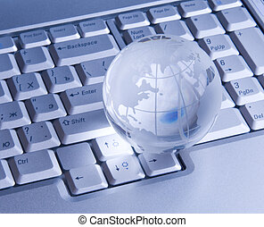 Glass globe on keyboard