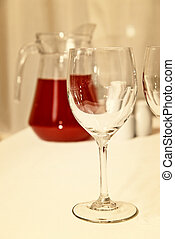 glass goblet and red beverage on the table