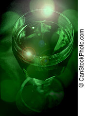 A glass goblet filled with mysterious green liquid.