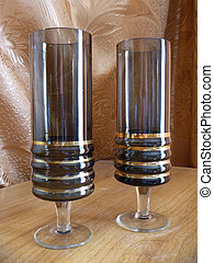 Glass goblets on brown background