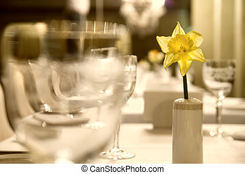 Glass goblets with flower on the table