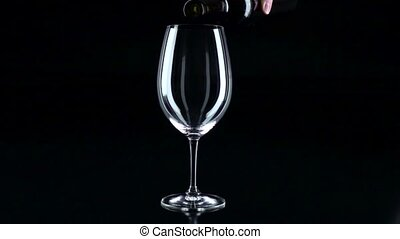 Glass in which the sommelier pouring red wine, black,...