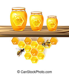 Glass jar and honey over piece of wood