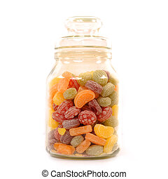 glass jar filled with candy isolated on white background