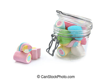 glass jar full of colorful marshmallows on white background