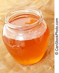 glass jar of fresh honey