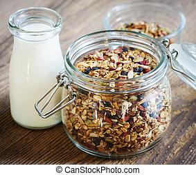 Glass jar of granola and milk