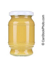 Glass jar of mustard.