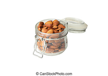Glass jar with almond isolated on white background