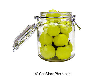 Glass jar with apples isolated on white background.