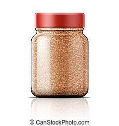 Glass jar with instant coffee.