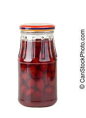 Glass jar with jam maded from cornelian cherries