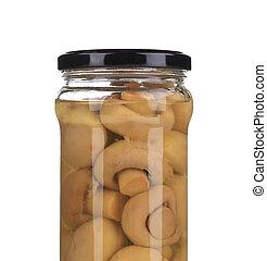 Glass jar with marinated mushrooms.