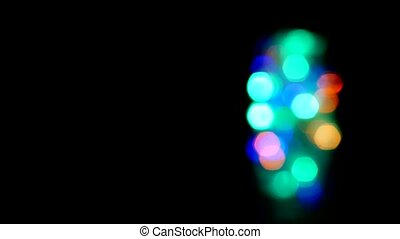 Glass jar with New Year's sparkling multi-colored lights, the new year, Christmas, copy space, decoration, defocus, blinking