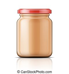 Glass jar with peanut butter.