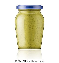 Glass jar with pesto sauce.