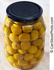 Glass jar with pickled olives