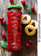 Glass jar with preserved cherries