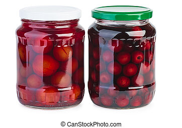 Glass jar with preserved plums and cherries