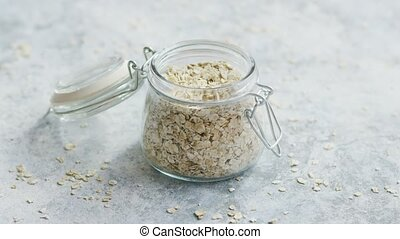 Glass jar with raw oats - Small glass jar full of oats...