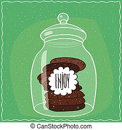 Glass jar with stack of chocolate cookies inside