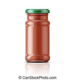 Glass jar with taco sauce.