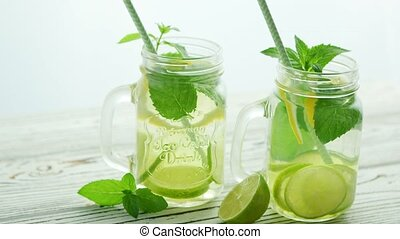 Glass jars filled with refreshing lemonade - Few glass jar...