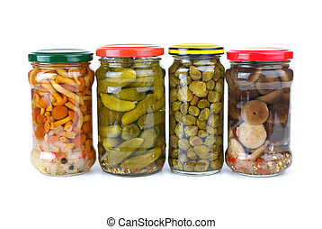 Glass jars with marinated cornichons, mushrooms and capers isolated on the white background