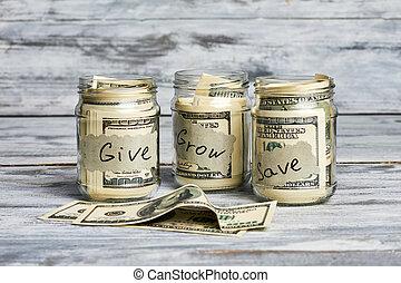 Glass jars with money.