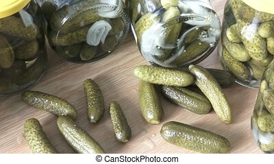 Glass jars with pickled cucumbers. Marinated pickled...