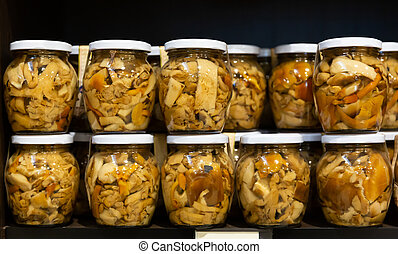 Glass jars with pickled mushrooms