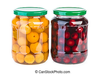 Glass jars with preserved cherries and apricots