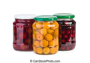 Glass jars with preserved cherries, plums and apricots