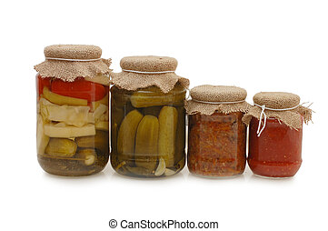 Glass jars with tinned vegetables isolated