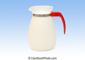 Glass jug of milk isolated on blue background