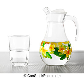Glass jug with water and glass Cup. Close up. Isolated on white background