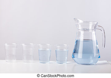 glass jug with water isolated on white background