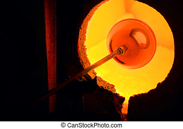 Glass kiln - Glass blowing process - softening glass in the...