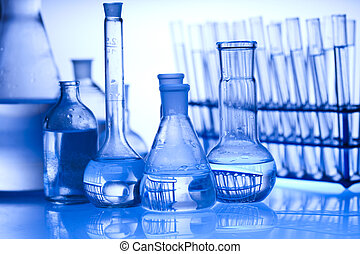 Glass laboratory equipment with whi - A laboratory is a...