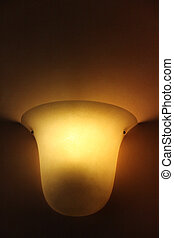 Glass lamp on painted old wall