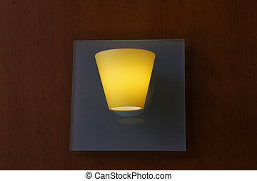 Glass lamp on wooden wall