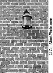 Glass lantern on brick wall