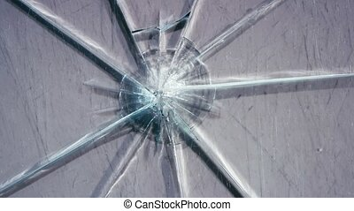 Glass lies on the table, broken into pieces. Close up -...
