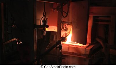 Glass making furnace in bottles factory. Tyumen - ...