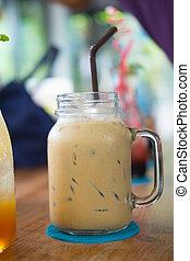 Glass mason jar with ice coffee