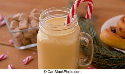 glass mug of eggnog, ingredients and sweets - christmas and ...