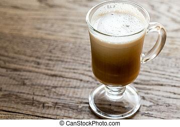 Glass mug with cappuccino