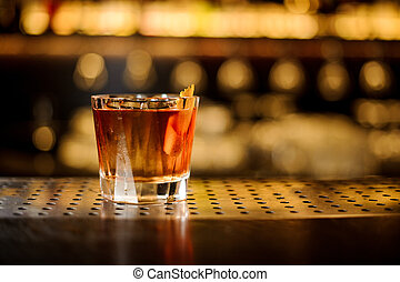 Glass of a Foreign Legion cocktail on the wooden steel bar counter